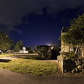 Dolmen of Crucuno, Plouharnel, Brittany, France. The Crucuno Dolmen is surrounded by lampposts. With so much light, it's hard to see anything other than Venus and the coachman's brightest stars.