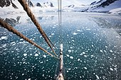 Landscape of sea and ice seen from the mast of a sailboat, Svalbard