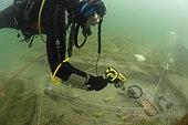 Passage of a metal detector, Archaeological excavations at a place of Roman worship in Lake Bourget, Savoie, France
