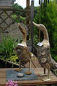 Garden decoration made of bamboo rhizome at the edge of a Zen garden pond, Jardin de l'Écriture et de la Poésie, Garden of Writing and Poetry, Eure et Loir, France