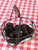 Truffes du Périgord, summer truffle, in a basket on a tablecloth, France