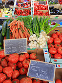 Seasonal vegetables and Tomatoes 'Coeur-de-Boeuf' on a market, price display, Périgueux, France