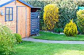 Wooden cabin in a garden, spring, north, France