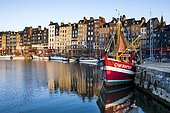 Houses and fishing boats at the old harbor with reflections in calm water, Vieux Bassin, Honfleur