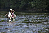 Guide to Fishing and Young Woman in Apprenticeship,, Fly fishermen on the French-Swiss Doubs river, La Goule, Franche-Comté, France