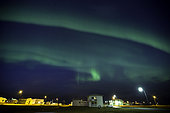 Northern Lights, Aurora Borealis over a village in the Snaefellsnes peninsula, Iceland.