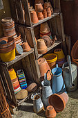 Stored terracotta pots and traditional watering cans, Provence, France