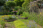 Square foot kitchen garden and tomatoes supported, Provence, France
