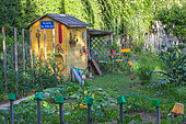 Garden shack with seating aera in a kitchen garden in june, Provence, France