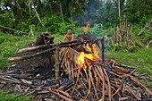Singeing of a pig Mentawai, Siberut, Indonesia