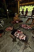 Division of the cooked pork(. Mentawai. Siberut, Indonesia