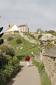 Seniors hiking on the island of Bréhat, Brittany, France