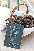 Truffles in a wicker basket in a market, summer, Provence, France