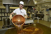 Manufacture of sweets, the boiled sugar is poured on the table, Confiserie des Hautes Vosges, Plainfaing, France