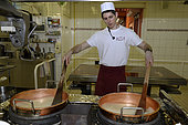 Manufacture of sweets, making candy baking sugar in copper pots, Confiserie des Hautes Vosges, Plainfaing, France
