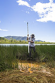 Christophe Durlet (lecturer at the University of Burgundy) carries out a coring with a Russian corer. Study of the impact of the exploitation of Nickel. North Province, New Caledonia