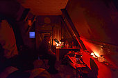 Inside a hut in Greenland, Red light to avoid being dazzled, Greenlande, February 2016