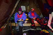 Inside the hut, 18 hours of pitch-dark night, explorers have to keep themselves busy, Greenland, February 2016