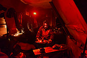 Explorers in a small hut in Greenland, February 2016, The red light doesn't dazzle them