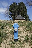 Fire-fighting reservoir with blue suction pole equipped with a dry fire safety device with visible plugs that enable an off-ground connection of the mobile fire-fighting equipment from a water reservoir in Senneville-sur-Fecamp, Normandy, France