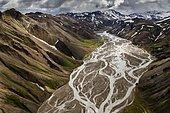 Aerial view, Joekulgilkvísl braided river, rhyolite mountains partially covered with snow, Landmannalaugar, Fjallabak conservation area, Icelandic Highlands, Iceland, Europe