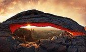 Sunrise at Mesa Arch stone arch, Canyonlands National Park, near Moab, Utah, United States, North America