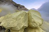Indonesia, Java Island, East Java province, Kawah Ijen volcano, sulfur flames and rocks