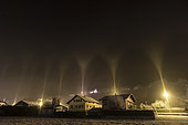 Light pillars in winter, Thyez, Alps, France. In an icy atmosphere (-7 ° C), artificial light in the town of Thyez is reflected in ice crystals suspended in the air. This phenomenon known as light pillars is common in the far north but rare in our latitudes.