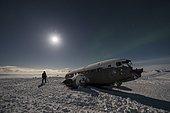 Shooting in midnight sun of the carcass of a US Army DC3 on the beach of Sólheimasandur, Iceland
