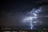 Thunderbolt above the clouds around Geneva, Ain, France