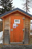 Pit toilet in ski resort, Savoie, Alps, France