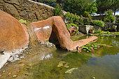 Saint Adrian Garden ponds - the Philia fountain, Philia is the Greek goddess for friendship, with stunning vegetal hair, Hérault, France