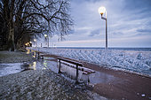 Bench and balustrade frozen in Evian, on the front of Lake Geneva, France