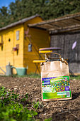 Bag of repellent plant sheaths against the Colorado potato beetles, Vegetable garden, Provence, France