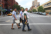 Urban Beekeeping - Andrew Coté beekeeper, founder of the New York City Beekeepers' Association, Adam Johnson, a novice, and Troy Seidman, a curious friend, go on foot to inspect the hives in the apiaries in East Village in New York. USA