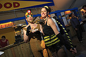 Urban Beekeeping - Pollination week in New York started with a costume ball on June 22, 2009. A couple of bees out for a good time eat a hot-dog covered in honey-flavored mustard. Forbidden beekeeping is underground…but so chic… USA