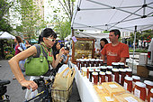Urban Beekeeping - At the organic market on Union Square, Andrew Coté sells his honey from New York and also the honey that he produces in Connecticut to a trendy clientele. He works with Justfood.org to have a bigger base in the circle of community and educational gardens. USA