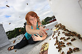 """Urban Beekeeping - Megan Paska, 29 years old, from Brooklyn. She started beekeeping in January. """"I come from Baltimore in Maryland but my family is from the country and during my childhood, we had a garden. For me, who came to New York recently, it is also a way of meeting people with different interests. I am fascinated. I open my hive every week, watching the bees is for me like meditation, a way to relax. I work for a company that makes children's clothing"""". USA"""