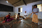 The honey of the untouchables, Then Mari with his wife, granddaughter and nephew in the village community center, make a rope ladder that will be used for honey hunting. Thaladassadatti village. Tamil Nadu, India