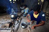 The honey of the untouchables, At the base-camp, the group of honey hunters enjoys a light meal of rice and vegetable with sweet tea. Tamil Nadu, India