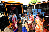 The honey of the untouchables, Irula women load honey containers in front of the Hasanur resource center. Tamil Nadu, India