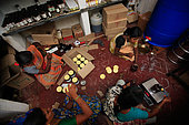 The honey of the untouchables, Honey potting by the group of Hasanur Irula women. Tamil Nadu, India