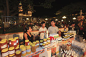 A beekeeper sells his honey at the evening market in Campeche. Mexico stingless honeybees and equitable trade