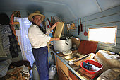 Constantin Cazan has come to help his father Gheorghe during the two days of harvesting and extracting. The extraction takes place in the cabin of the converted caravan. Romanian traveling beekeepers, Romania