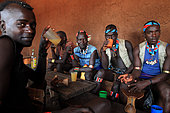 On market days in the Bana village of Kako, the mead bars do great businesses with the Bana men who come to drink liters of teji, which, though not very alcoholic, inebriate quickly. The Honey tribe, Omo valley, Ethiopia