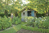 The tool shed and the scarecrow in the kitchen garden, The Garden of Mary, Neuilly-en-Sancerre, The Pinard Wood, Cher, France