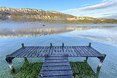 Morning mist on Lake Annecy in autumn, Haute Savoie, Alps, France