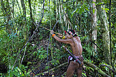 Man hunting with his bow and poisoned arrows, Pulau Siberut, Sumatra, Indonesia