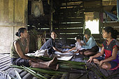 Women in the kitchen preparing sago, Pulau Siberut, Sumatra, Indonesia