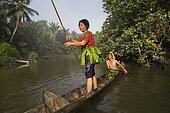 Women going to fish on their dugout, Pulau Siberut, Sumatra, Indonesia